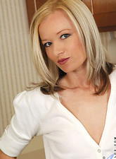 Heidi Hanson  Skinny cougar Heidi Hanson makes her dildo slippery with her mouth and fucks herself in the kitchen