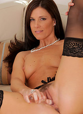 India Summer  Horny Anilos cougar in black stockings thrusts a glass dildo in her milf pussy