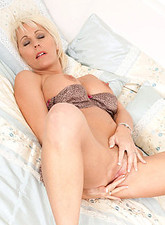 Jan Burton  Horny cougar with huge tits masturbates with a small toy in her bedroom