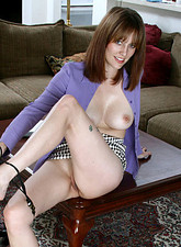 Sexy secretary Justine pops out her perky tits and slides off her sheer pantyhose