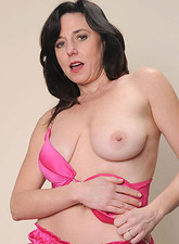 Karen Kougar  Attractive milf Karen Kougar has fun as she skillfully rides the monkey rocker