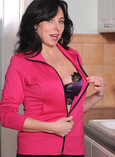Karen Kougar  Mature Anilos Karen Kougar stuffs her cougar pussy with a crystal clear glass dildo
