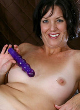 Glamorous Anilos Katie stuffs her pussy with a purple vibrator in her bedroom