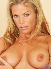 Kayla Synz  Experienced milf kayla synz pinches her large brownish erect nipples