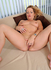 Kelly Leigh  Horny mature Kelly Leigh dips her experienced fingers in her hot milf pussy