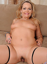 Kelly Leigh  Mature Anilos Kelly Leigh shows off her tender tits and pussy on the couch