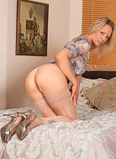 Lailani  Seductive cougar Lailani fingers her mature pussy while wearing sheer stockings