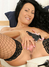 Anita Gyongy  Fiery hot brunette cougar wearing fishnets spreads her honey filled pussy