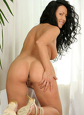 Anita Gyongy  Sensational long haired brunette laura strips down to nothing in the office
