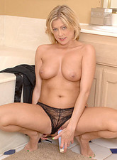 Lya Pink  Totally nude cougar Lya Pink masturbates with a stiff dildo inside her bathroom