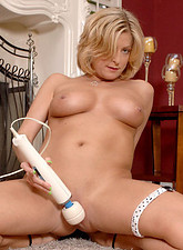 Lya Pink  Seductive cougar shows off her huge tits while busy fingering her tight Anilos snatch