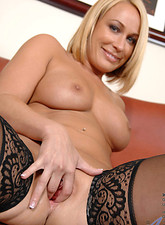 Mellanie Monroe  Voluptuous Anilos blonde in black stockings has a great time fingering her juice box