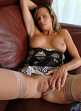 Montana Skye  Busty Anilos Montana Skye dips her experienced fingers deep within her craving cougar pussy