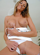 Montana Skye  Sensual cougar Montana Skye lovingly torments her bald mature pussy with the purple rabbit