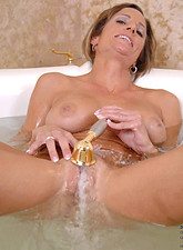Montana Skye  Anilos Montana Skye gets her nude body in the bathtub and sprays her pussy with the shower head