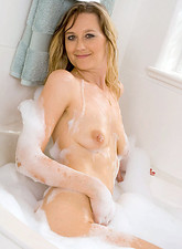 Nicole Logan  Seductive Nicole Logan takes a bubble bath and ends up masturbating with the rabbit toy