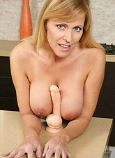 Nicole Moore  Busty Anilos Nicole Moore strips off her clothes and sucks on a thick dildo