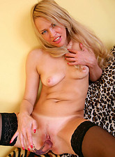 Alluring mature Olga takes off her clothes and strokes her pink Anilos juice box with a dildo