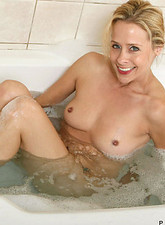 Payton Leigh  Mesmerizing blonde anilos soaks in the bubble bath and explores her mature pussy with her fingers
