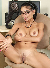 Persia Pele  Tempting secretary gets naked and plunges the rabbit in her mature pussy in the office
