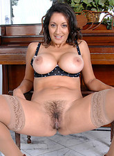 Persia Monir  Persia Monir pops out her huge mature tits while spreading her legs for a view of her hairy pussy