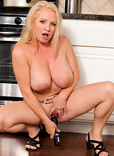 Rachel Love  Anilos cougar proudly displays her big tits and plays with a toy