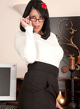Busty business woman Raven flaunts her sultry milf body in the office