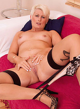 Sally Taylor  Seductive hot milf Sally Taylor satisfies her pussy with a silver dildo on the couch