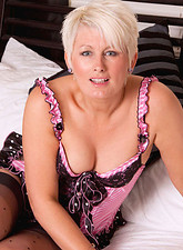 Sally Taylor  Beautiful cougar Sally Taylor masturbates with a massive sex toy in her bedroom
