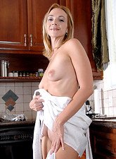 Samantha Rae  Samantha Rae exposes her natural breasts while spraying her milf pussy in the sink