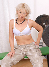 Samantha White  Seductive blonde milf strips her clothes off and spreads her pink snatch while sitting on a weight bench