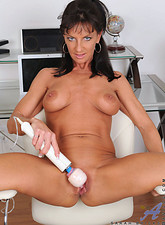 Sarah Bricks  Cougar Sarah Bricks fucks her sweet pink pussy using her magic wand on the chair