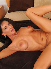 Sarah Bricks  Horny cougar Sarah Bricks really loves sucking cock and rides on it on the bed really good