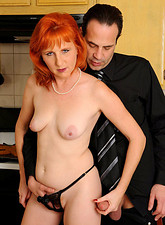 Sasha Brand  Horny redhead Sasha Brand gets an intense hardcore fucking from a stud in the kitchen