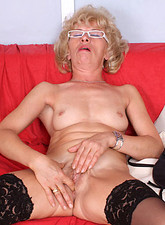 Susan Lee  Lonely naked mature housewife Susan Lee comforts herself by fingering her Anilos pussy on the sofa