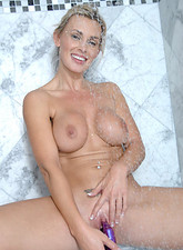 Tanya Tate  Alluring mature babe Tanya Tate gently strokes her pussy with the rabbit toy while showering