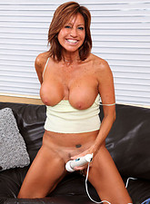 Tara Holiday  Brunette cougar proudly displays her big tits as she plays with her trusty vibrator