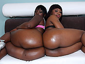 Chocolate & Carla - Slutty black slut takes it doggy up her huge phat ass!