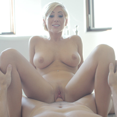 Tasha Reign - Busty blonde gives bathroom blowjob.
