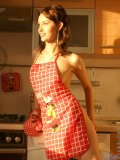 Sexy girl adel has some fun in the kitchen wearing only an apron and a thong