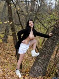 Nubile Adrianne Black teases her shaved pussy outdoors in the forest