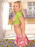 Sweet andi in dotted skirt spreading legs shows her panty