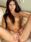 Long haired Nubile Anechka bares off her petite boobs while spreading her shave pussy in sofa