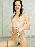 Teen Arianna washes her small breasts and hairy pussy in the shower