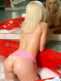 Such a cute teenie blonde nubile ashley is playing in the bathtub all wet and bubbly