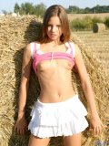 Slim tasty teen in skirt without undies flashing and stripping down on the barn