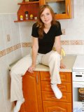 Hot teen nubile beth sits on the counters in the kitchen and slowly gets naked