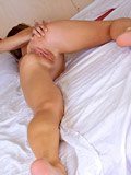 Playful Nubile gets naked in bed and pleasures her cock craving juice box
