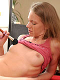 Petite Nubile Bony strokes her pussy with a makeup brush