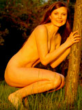 Cock thirsty teen nude on grassy land fantasizing cock on the tree trunk